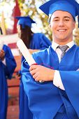 image of graduation hat  - Graduate students wearing graduation hat and gown - JPG