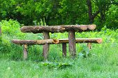 Table And Benches Made Of Logs Are In The Forest