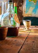 picture of vinegar  - Bottle of vinegar on a table - JPG