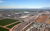 stock photo of hockey arena  - Farming and Football mixed use facility in Glendale Arizona from above - JPG
