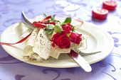 Served plate with napkin and rose