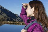 Woman Watching The Alps Mountain Landscape During A Hiking Trip