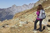 Woman Enjoying The Swiss Alps During Hiking In Autumn