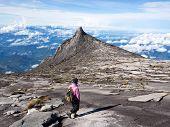 Climber At The Top Of Mount Kinabalu In Sabah, Malaysia