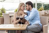Affectionate young couple spending quality time at outdoor restaurant