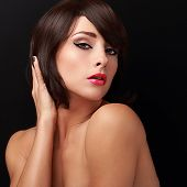 Sexy Brunette Woman With Bright Makeup, Red Lips And Short Hair Style Looking