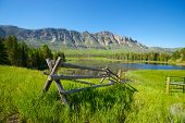 Wooden Fence And Mountain Scene