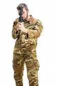 pic of shotgun  - A soldier sights on shotgun on white background - JPG