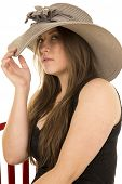 Woman Black Dress Red Chair Hat Look Serious