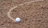 Golfball in bunker