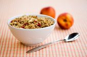 Breakfast cereal with dried fruits and fresh peaches