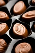 Delicious milk chocolate with very shallow focus