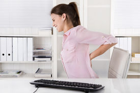 foto of sick kidney  - Young woman sitting with backache in the office - JPG