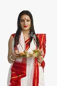 image of pooja  - Beautiful woman in a Bengali sari holding pooja thali - JPG