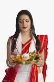picture of pooja  - Woman in a Bengali sari holding pooja thali - JPG