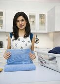 picture of homemaker  - Woman folding laundry - JPG