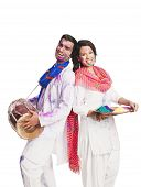 stock photo of holi  - Couple celebrating Holi with colorful paints and a drum - JPG
