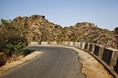 foto of guru  - Road passing through a mountain range - JPG