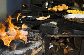 stock photo of laddu  - Traditional snacks and sweets being cooked at a store - JPG