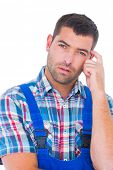 stock photo of scratching head  - Portrait of confused manual worker scratching head on white background - JPG