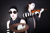 Two Mimes Playing A Violin For The Money