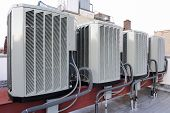 foto of air conditioning  - A row of air conditioning units on a rooftop - JPG