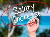 picture of paycheck  - Man Hand writing Salary Increase with black marker on visual screen - JPG