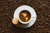 foto of continent  - Still life photography of hot coffee beverage with map of America continent  - JPG