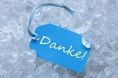 pic of thankful  - Light Blue Label With Blue Ribbon On White Transparent Curshed Ice Cubes As Background - JPG