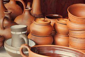 foto of loamy  - Different kinds of ceramics pots taken closeup - JPG