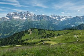 stock photo of snow forest  - Summer view in the swiss alps taken from above Champery towards Les Dents du Midi - JPG