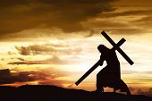 Silhouette Of Jesus Carry His Cross poster