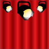 focos de teatro con cortina detrás