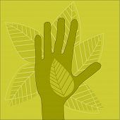 green hand with leaves