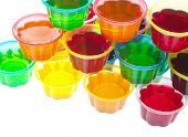 Colorful jellies in plastic bowls