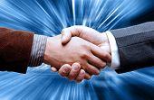 handshake over technology background