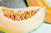 Постер, плакат: Sliced Melon With Seed On Wooden Board other Names Are Cantelope Cantaloup Honeydew Crenshaw Ca