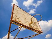 old basketball ring against blue sky