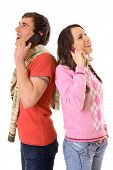 young man and woman talking on the mobile phones