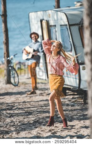 Hippie Girl Dancing While Man