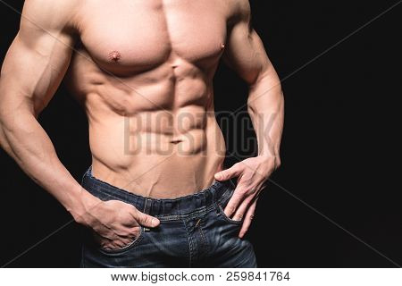 poster of Fitness Concept. Muscular And Fit Torso Of Young Man Having Perfect Abs, Bicep And Chest. Male Hunk