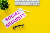Social Security Concept. Printed Words Social Security On Yellow Office Desk Background With Compute poster