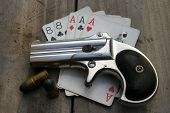 Circa 1889, Model 95, Type II Model 3 Double Derringer, on antique wooden table aces and eights aka
