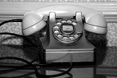 antique telephone in black and white