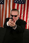 a Secret Service Agent points his weapon at YOU the Viewer