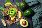 Sandwiches with rye bread, guacamole and fresh avocados poster