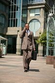 an african american business man outside of his office building