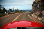 view of maui from a convertiable rental car with
