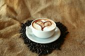 Coffee for Coffee Lovers, a cup of Coffee or  espresso with a Heart in the foam nestled in a bed of