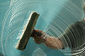 picture of window washing  - a window washer soaps up a window for window washing - JPG